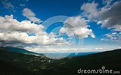 Landscape of the city on the coast, under a blue sky