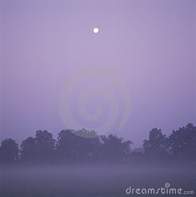 Landscape at dawn with full moon