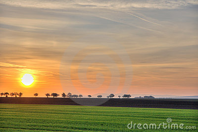 Landscape with distant road at sunrise