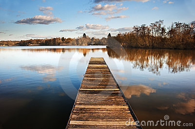 Landscape of fishing jetty on calm lake