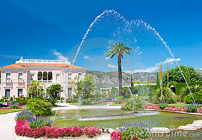 Landscape with fountain. colorful flowers