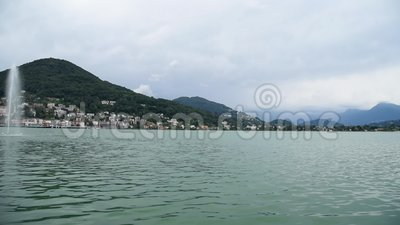 Landscape of Lake Lugano - Ceresio with fountain cloudy day. stock footage