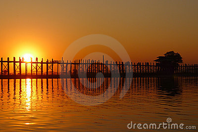 Landscape of an old wooden bridge at sunset