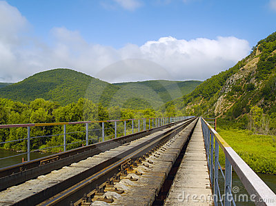 Landscape with railway line and hills