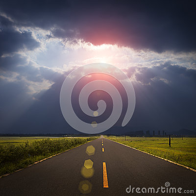 Landscape road, clouds and god ray
