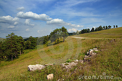 Landscape with stones and road on hill