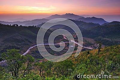 Landscape of sunrise over mountains in Kanchanabur
