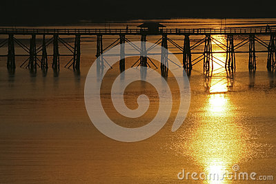 Landscape view of silhouette bridge across river