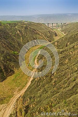 Lane between mountain bridge
