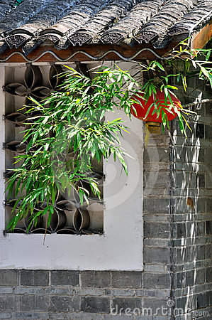 Lantern and green bamboo on Chinese house