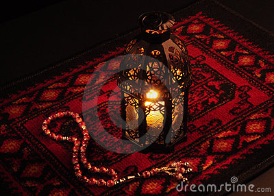 A lantern and rosary