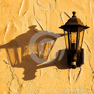 Lantern with shadow on wall.