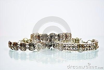 Three silver bangles