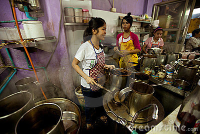 Lao girls working in a cafe in Bangkok Editorial Stock Photo