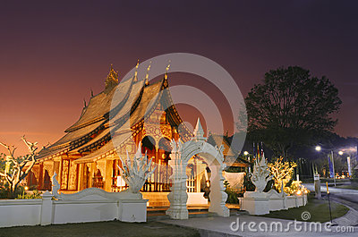 Laos wooden temple in sunset