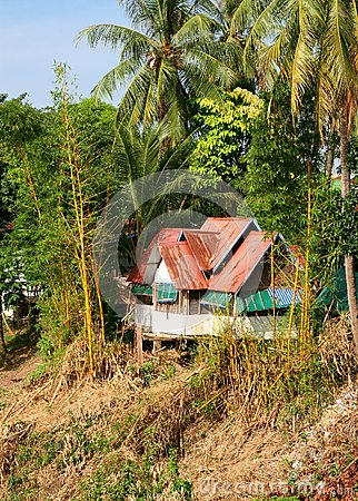 Idyllic ancient Laotian bungalow in the jungle, Laos
