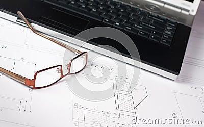 Laptop on blueprint