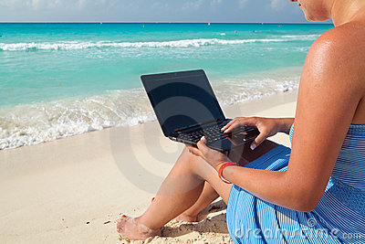 Laptop at the Caribbean sea