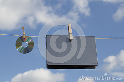 Laptop And A CD On Clothesline