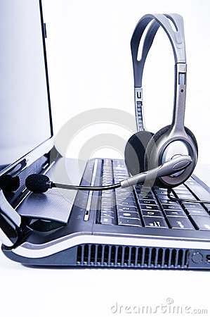 Laptop computer with headset on keyboard