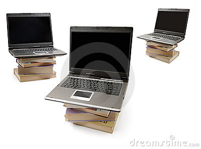 Laptop Computers on Piles of Books