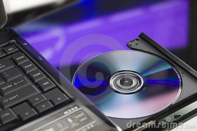 Laptop with a disk dvd. Close up.