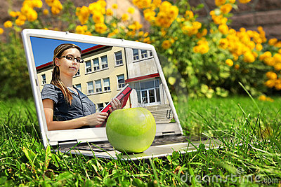 Laptop with female student on screen