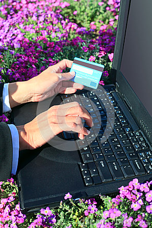 Laptop flowers and credit card