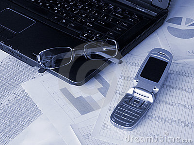 Laptop, glasses and mobile phone