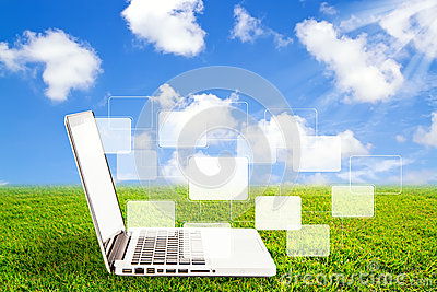 Laptop on grass and virtual buttons