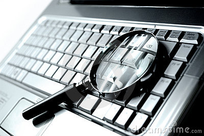Laptop + Magnifying Glass