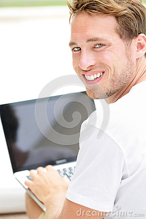 Laptop man smiling happy using computer outside