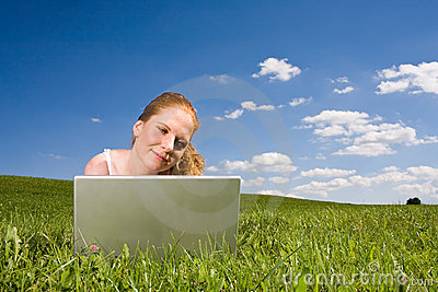With Laptop on meadow