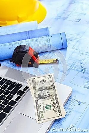 Laptop, money and blueprint