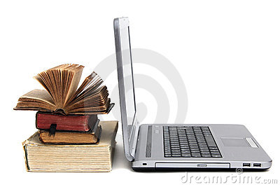 Laptop and old books