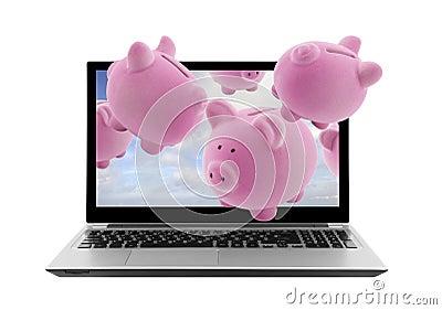 Laptop and piggy banks