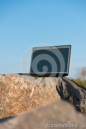 Laptop on rocks