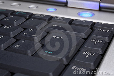 Laptop s keyboard with blue on-button
