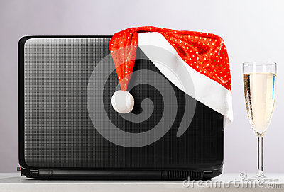 Laptop with santa hat and wine