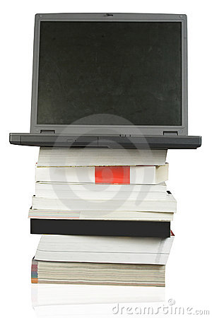 Laptop on top of books