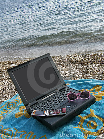Laptop, towel, sun glasses, cellular