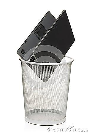 Laptop in a trash bin