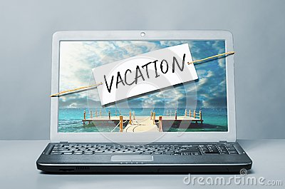 Laptop with vacation note