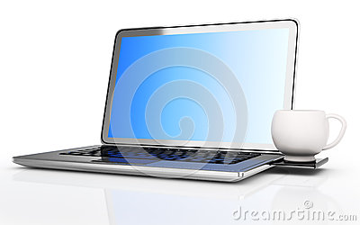 Laptop with white cup