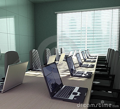Laptops in an empty room