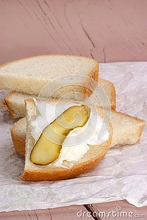 Lard with gherkin on bread