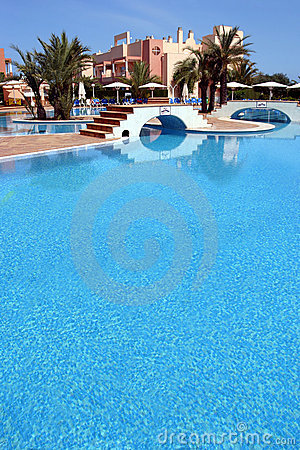 Large, blue swimming pool in luxurious Spanish complex