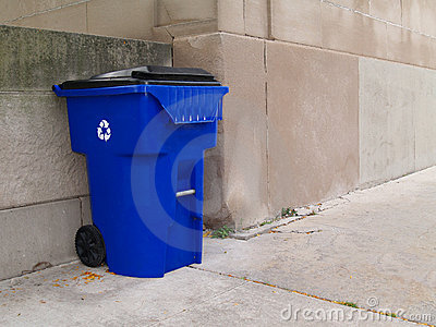 Large Blue Trash Can on a City Sidewalk