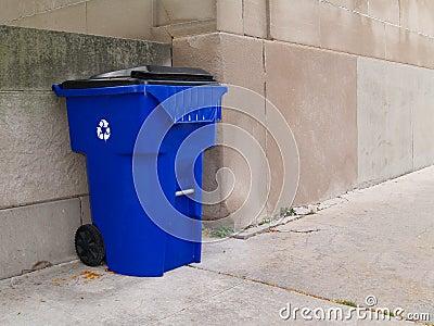 Large Blue Trash Can on a City Sidewalk