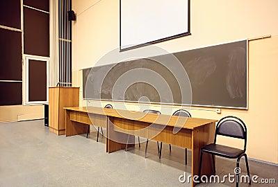 Large classroom, big blackboard, wooden table